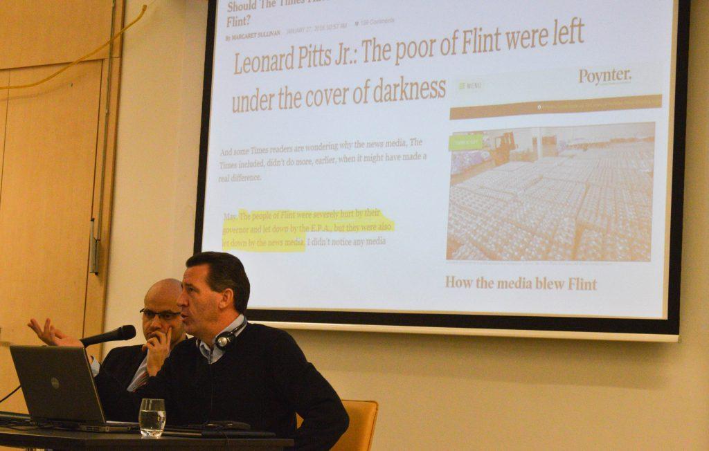Vincent Duffy és a háttérben egy, a vízszennyezésről készült cikk
